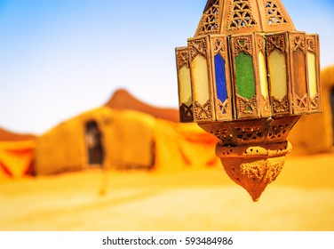 coloreful berber lamp with traditional nomad tents on background
