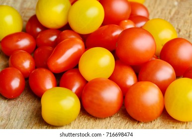 Colorful 3 kind of tomatoes on wooden floor.