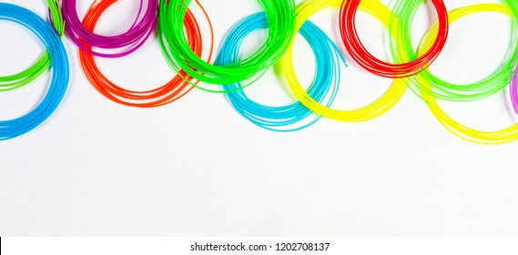 Colorful 3d pen filaments on white background, top view