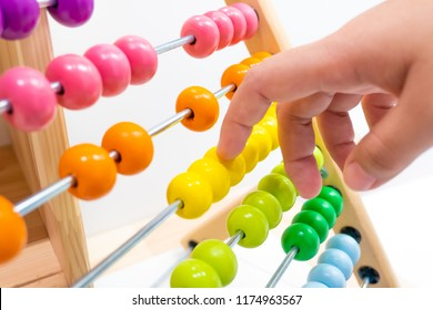 colorful abacus children toy hand playing for practice math and calculation learning for kids.