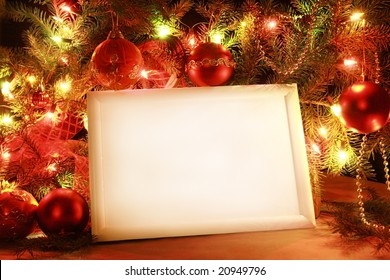Colorful abstract background with Christmas lights and white frame.