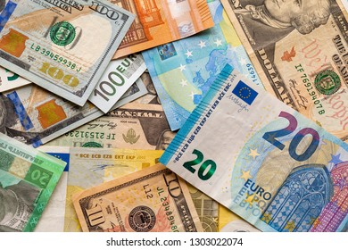 Colorful abstract background of different banknotes., Ukrainian national currency bills, American dollars and euro. Money and finances, succesful investment concept.