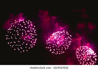 Colorful Abstract blurred fireworks for celebration christmas,happy new year and anniversary background,Motion by wind blurred firework fall on night sky background.Vivid Color vintage  style.