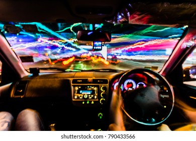 Colorful Abstract Defocused motion blurred speed light trails with console inside Car in Night scene