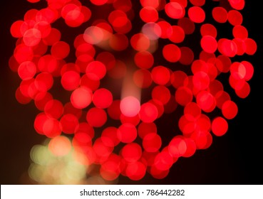colorful of abstract firework ligth blurred bokeh background and red heart bokeh is valentine day concept.