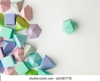 Colorful abstract geometrical composition. Three-dimensional prism pyramid rectangular cube, dodecahedron on white paper background. Geometry models