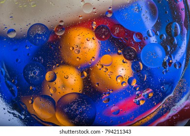Colorful abstract macro background with oil drops in water