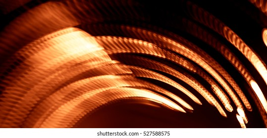 Colorful abstract trails of light. Dots, lines and bokeh on dark background. Long exposure.