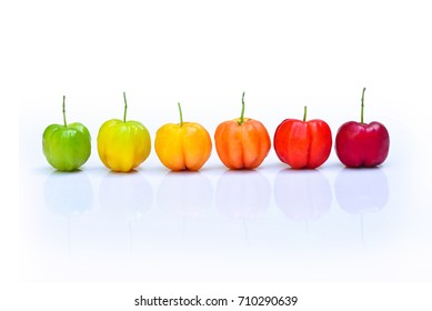Colorful of Acerola cherry after aging on white background, High vitamin C and antioxidant fruits