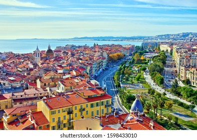 Colorful aerial panoramic view over the old town of Nice, France, with the famous Massena square and the Promenade du Paillon, from the roof of Saint Francis tower