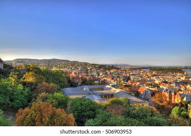 Colorful  aerial picture of the skyline of Budapest with trees and river Danube and in summer during sunset