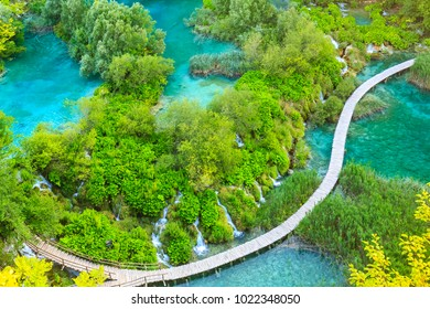 Colorful aerial scenic view on the forest, trees, landscape, walking path over blue water lakes and waterfalls of Plitvice lakes, Croatia
