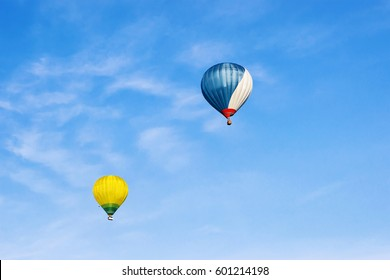 Colorful Air balloons flying high in the sky in Vilnius, Lithuania