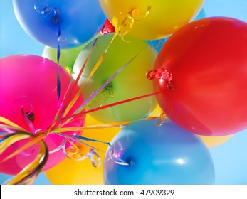 Colorful air balloons over blue sky background