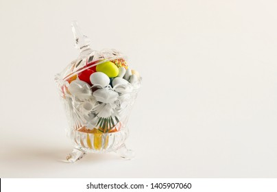 Colorful almond candies in the stylish,crystal candy bowl.The Sugar Feast concept.Left space for any text message.