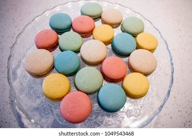 Colorful Almond Cookie Macarons or Macaroons on Glass Platter.