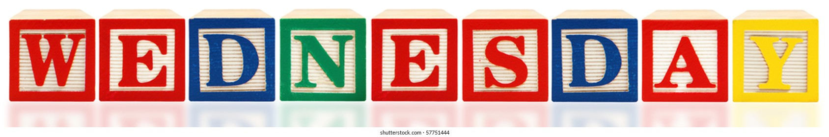 Colorful alphabet blocks spelling out Wednesday on white