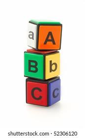 Colorful alphabet blocks stacked on white background