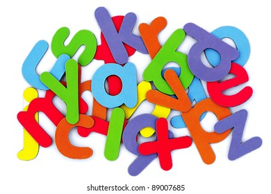 Colorful alphabet scattered on white