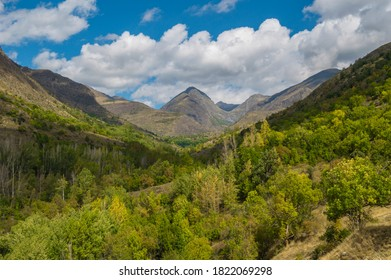 Colorful alpine valley landscape with a cloudy blue sky in Unarre, Lleida, Catalonia. Green forests and high mountains in Pyreness' Alt Pirineu natural park, in Spain. - Shutterstock ID 1822069298