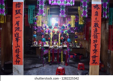 Colorful altar made in occasion the ritual redeeming the vow in a village of Guizhou. Translation of text: worship nature and ancestors.