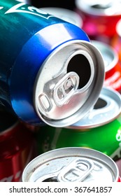 Colorful aluminum cans isolated on white background