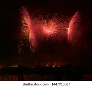 Colorful amazing fireworks in Luqa, Malta with house lights in the background,explode, dark sky background and house light. Malta.Maltese fireworks.Pyrotechnics show