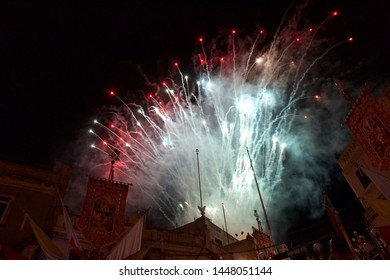 Colorful amazing fireworks in Luqa, Malta with people sillouthes in the background,explode, Malta.Maltese fireworks.Pyrotechnics show