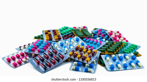 Colorful of antibiotic capsule pills isolated in blister pack isolated on white background with copy space. Antibiotic drug resistance. Pharmaceutical industry. Antimicrobial resistance concept.