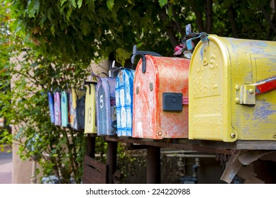 Colorful antique mailboxes on Canyon Road in Santa Fe, NM