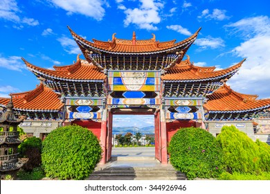 Colorful arched gate entrance of chinese Temple under blue sky background in Dali, Yunnan China.