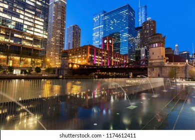 Colorful architecture of Chicago along Chicago River at night. Chicago, Illinois, USA.