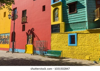 Colorful area in La Boca neighborhoods in Buenos Aires. Street is a major tourist attraction & the area is filled with colorfully painted buildings.