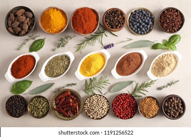 Colorful, aromatic spices and fresh herbs in a bowls. Top view.