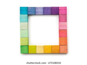 Colorful arrangement of wooden blocks arranged in a frame or square. isolated on white.Flat lay or top view.
