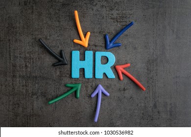 Colorful arrows pointing to the word HR at the center on black cement blackboard wall, represent Human Resource department, hiring new job or position in company.