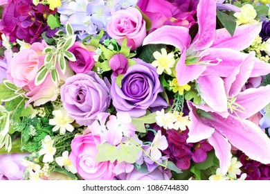 colorful of artificial flowers, colorful flowers bouquet, colorful of the plastic and fabric flowers