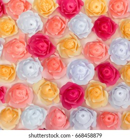 colorful artificial paper flowers background and texture