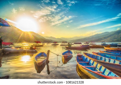 Colorful artistic HDR image of Boats on Fewa(Phewa) lake in Nepal at evening