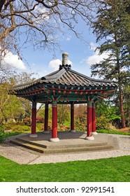 Colorful asian gazebo in garden
