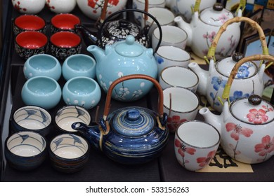 Colorful asian teapots and cups in a market stall in Hong Kong, China
