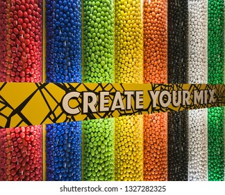 Colorful assorted candies and sweets background in vertical glass tubes in the supermarket. Create your mix