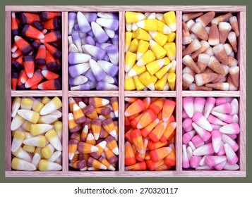 colorful assorted candy corn in wooden tray