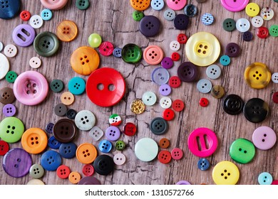 colorful assorted sewing buttons on a table. vintage buttons on a wooden background