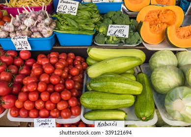 A colorful assortment of fruits and vegetables neatly and attractively arranged on stands for sale at Riga Central Market, Latvia