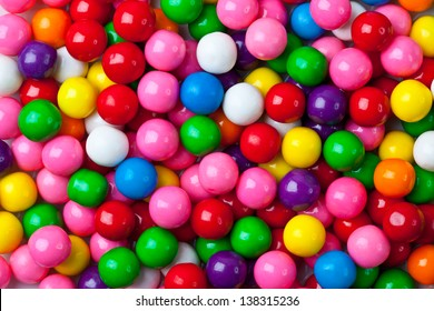 A colorful assortment of shiny round gumballs.