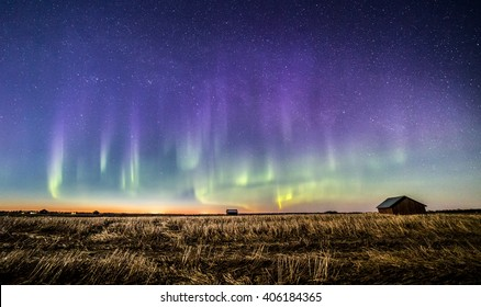 Colorful auroras in Finnish countryside after sunset