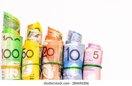 Colorful of Australian Dollars roll with all denomination on white background