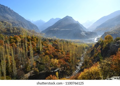 Colorful of autumn in Hunza valley with Karakoram mountain as background in northern area of Pakistan