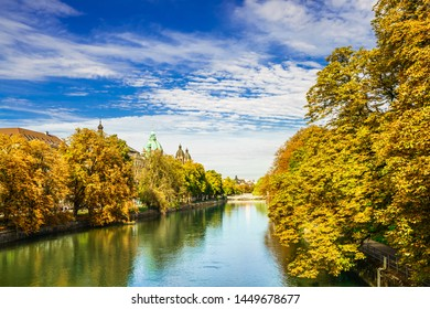 Colorful autumn landscape of Isar river in Munich, Bavaria